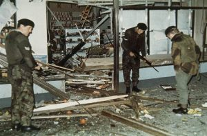 British troops sift through the ruins of a supermarket after a bomb exploded in Cavehill Road, Belfast, Northern Ireland in 1971