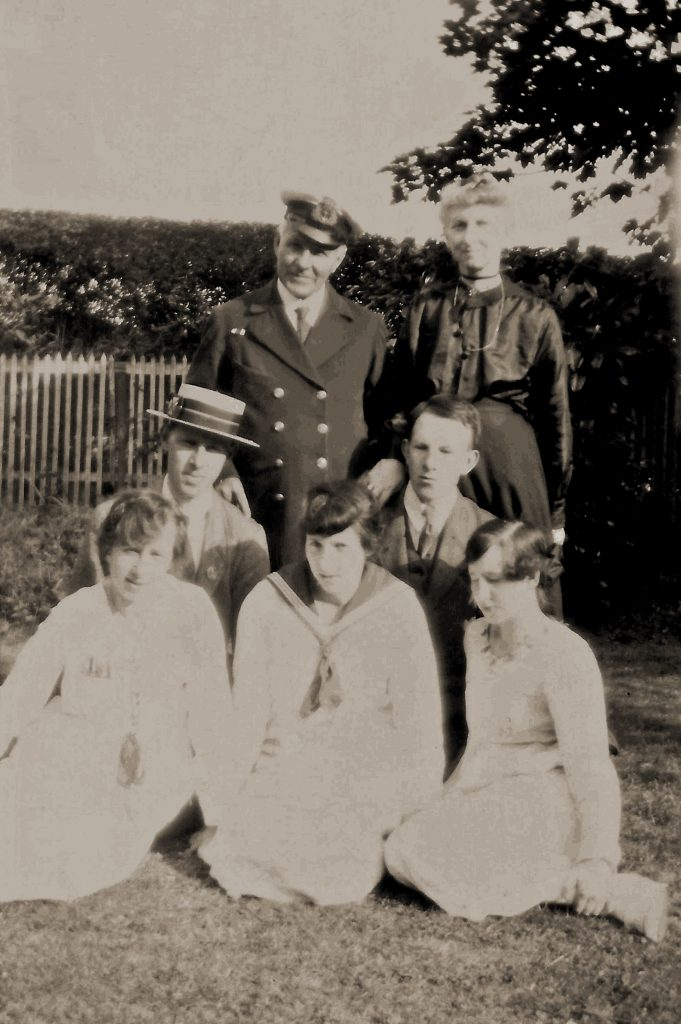 Poore Family in Belfast, Ireland shortly before their 1920 immigration to Canada; back row: John Henry Poore with wife Mary Agnes Cambridge Poore; middle row: left to right; Henry, Lewis; bottom row: left to right; Olive, Chris, Carol