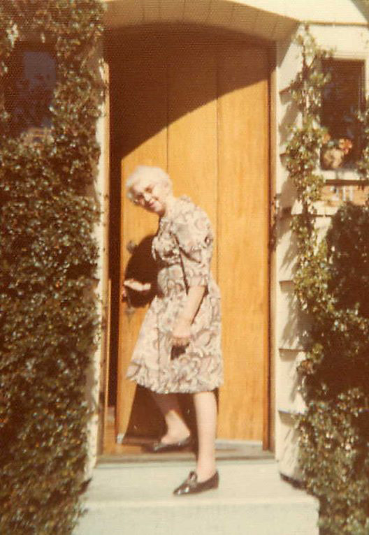 Chris Kerley in doorway of her home in Ladysmith, British Columbia, Canada