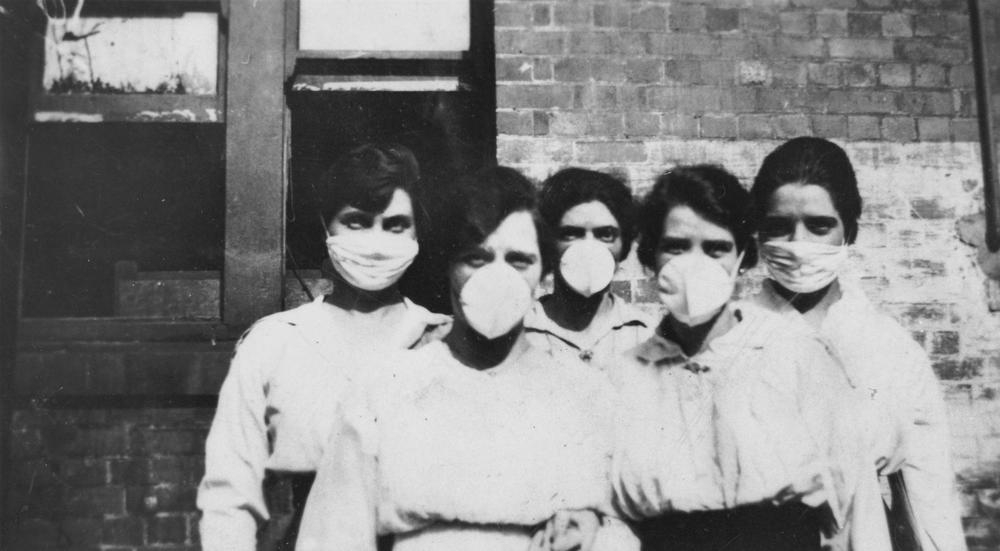 Women wearing surgical masks during the influenza epidemic in 1919<br /> Location: Brisbane, Queensland<br /> State Library of Queensland, Australia / No restrictions